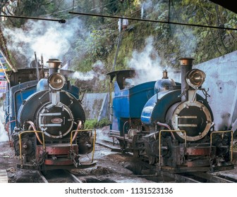 The Steam Engine of The Darjeeling Himalayan Railway, also known as the Toy Train ,is a 2 ft narrow gauge railway that runs between New Jalpaiguri and Darjeeling .
