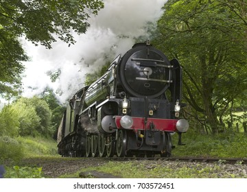 Steam engine pulling a train up a steep Cornish incline, England, UK.