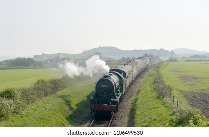 Steam engine through countryside on North Norfolk Railway