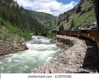 Steam engine train traveling from Durango to Silverton Colorado along the Animas river
