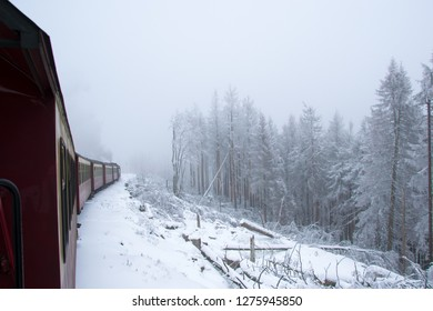 Steam engined narrow gauge train at the Brocken Bahn in National Park Harz in Germany during winter