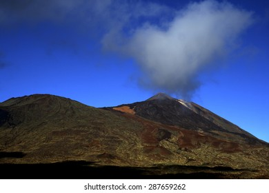 Steam and gas eruption in the volcano of Mount Teide in Tenerife, Spain, the Pico Viejo seen another Teide crater, lava flows red lava in the Canadas del Teide, National Park of Teide,