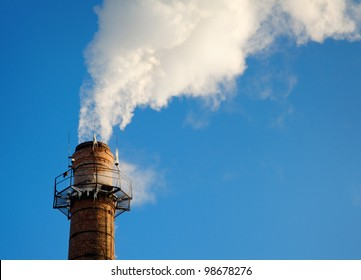 steam going out of chimney made of red bricks