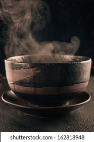 steam of hot soup in a soup bowl