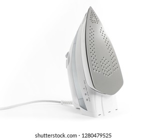 Steam iron laid on white background, elegant gray model