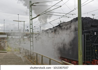 Steam locomotive at the exit from the Emder station