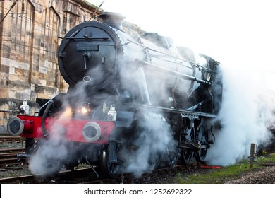 A steam locomotive in a siding at Carlisle Station, Cumbria, England, UK.