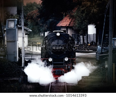 Steam locomotive is in the station
