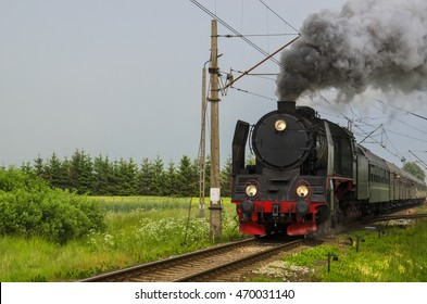 Steam locomotive with tourists in carriages on a tour of Western Pomerania in Poland