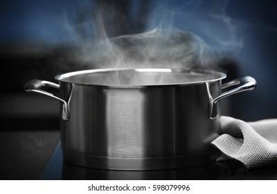 Steam over saucepan in the dark