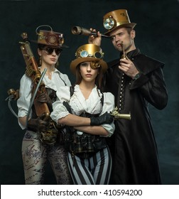 Steam punk style. The people of the Victorian era in an alternate history. Steampunk two women and a man.
