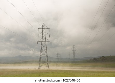 Steam from recent rainfall rises among power lines, carrying energy from Tasmania's hydro-electricity scheme.