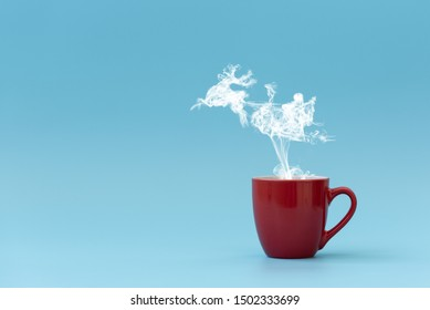 Steam in reindeer and Santa Claus into sled shape flying from coffee cup. Morning drink. Christmas or New Year celebration concept. Copy space.