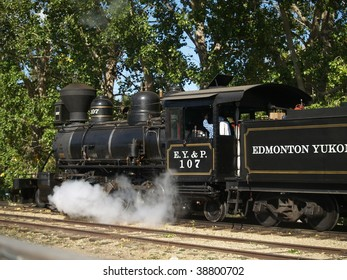 Steam is released in the drive stroke from a restored locomotive done up as an engine of the long defunct (1909) C Y & P Railroad