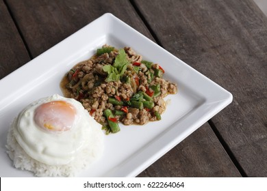 Steam rice with stir-fried minced pork and basil with Fried egg, Thai  food spicy.
