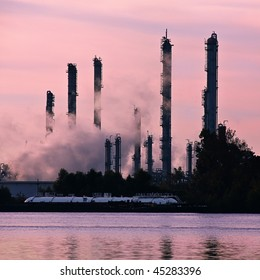 Steam rises from chemical plant alongside river