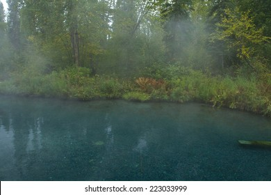 Steam rises from natural hot springs pool at Liard Hot Springs, British Columbia, Canada