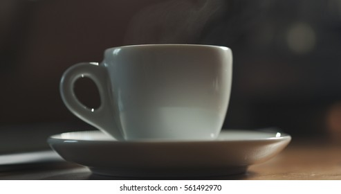 steam rising from espresso cup with fresh hot coffee shallow focus, 4k photo