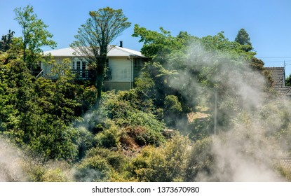 Steam rising from geothermal pool in front of Maori village in Rotorua, New Zealand.