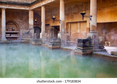 Steam rising off the hot  mineral water in the Great Bath, part of the Roman Baths in Bath, UK
