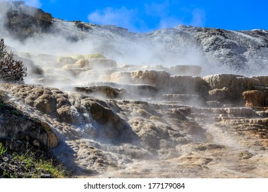 Steam rising from vents in Yellowstone National Park, Wyoming, USA