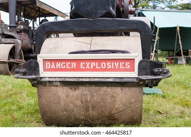 Steam Roller with Danger Explosives Sign on front. Traditional industrial machinery.