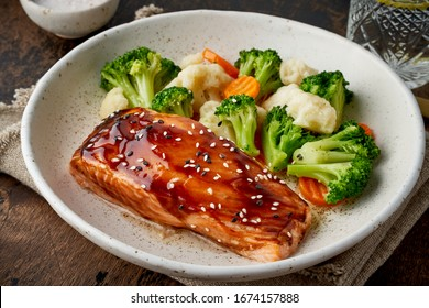 Steam salmon and vegetables, Paleo, keto, fodmap, dash diet. Mediterranean food with steamed fish. Oven baked asian dish with teriyaki. Healthy concept, gluten free, lectine free, top view