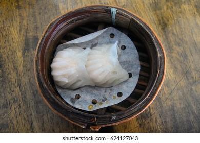 Steam shrimp dumplings , ha gao in bamboo basket : traditional chinese food.