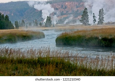 Steam from thermal areas at sunrise along the Firehole River in Yellowstone Park