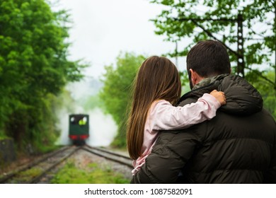 Steam train arrival. Attraction for kids and parents. Azpeitia, Spain. Father holding daughter. Selective focus.