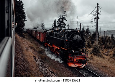 Steam train drives up to Brocken mountain, under a full head of steam