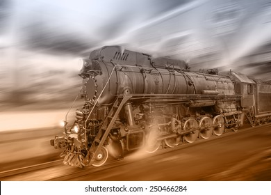 Steam train goes fast on the night station background. Vintage image.