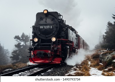Steam train in the Harz mountains, struggling up in fog on the mountain