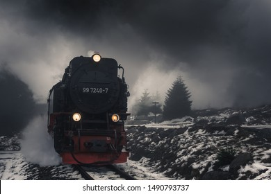 Steam train in the Harz mountains, struggling up in fog and snow on the mountain