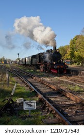 Steam train leaving the station