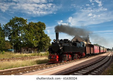 Steam Train Leaving a Station