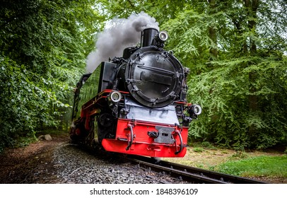 Steam train locomotive on railroad ride - Shutterstock ID 1848396109