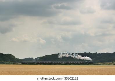 Steam train near Weybourne on the North Norfolk Railway, UK