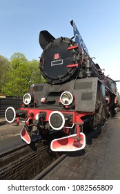 steam train on a blue sky background