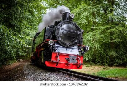 Steam train on railroad ride. Locomotive. Steam train