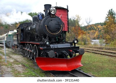 Steam train and water tank on an Autumn afternoon