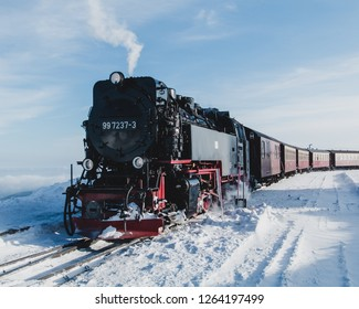Steam train in a winter landscape on top of the Brocken mountain