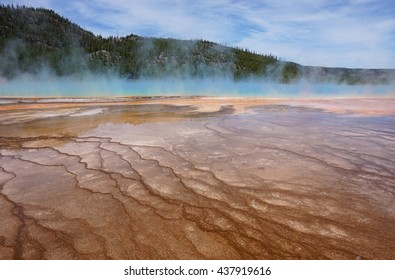 Steam vapor rising from the Grand Prismatic Spring in Yellowstone National Park which is the largest hot spring in the United States