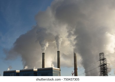 Steam vapor rising from the smoke stacks of a coal fired power plant station near Wheatland, Wyoming / USA.