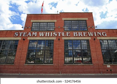 STEAM WHISTLE BREWERY, TORONTO JULY 2016 :Steam Whistle Brewing in Downtown Toronto.produces a premium pilsner lager packaged in distinctive green glass bottles.since  May 2000. July 24, 2016