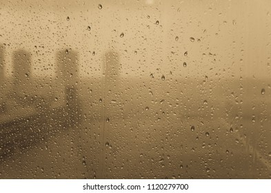 steam window of rain drop and cityscape background