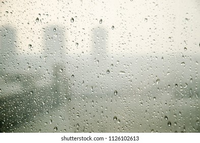 steam window of rain drop and cityscape background in black and white