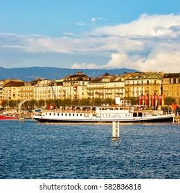 Steamboat in Geneva Lake near Promenade du Lac in summer, Geneva in Switzerland. People on the background