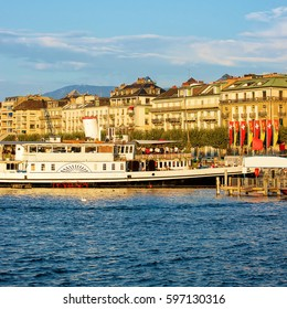 Steamboat in Geneva Lake at Promenade du Lac in summer, Geneva, Switzerland. People on the background