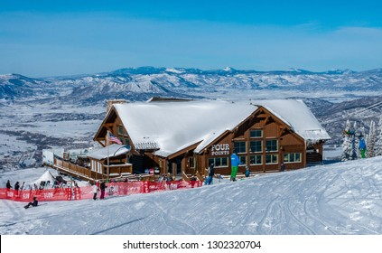 Steamboat Springs, Colorado - December 17, 2018: The Four Points Lodge on Mount Werner of the Steamboat Springs Ski Resort can be seen down-slope with a view of the Rocky Mountains in the background.
